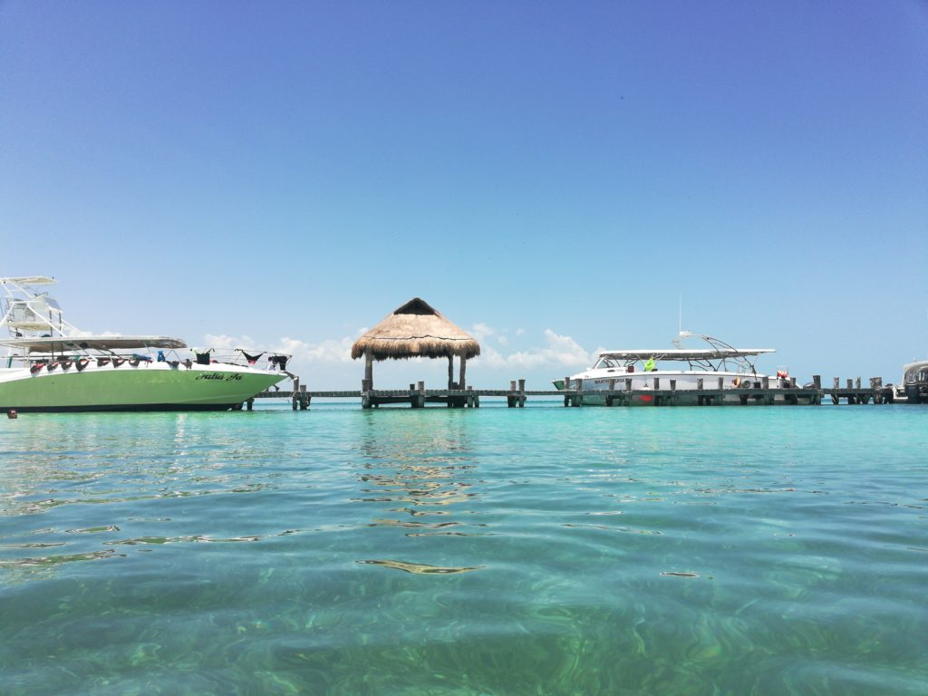 A dock in the crystal waters off Isla Contoy, Mexico