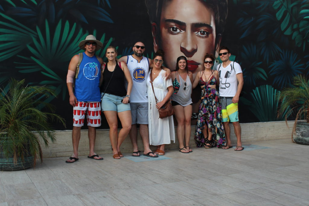 Group of people in front of the Frida Kahlo mural in Playa del Carmen, Mexico