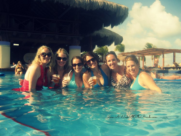 Women enjoying the hotel pool in Cancun Mexico