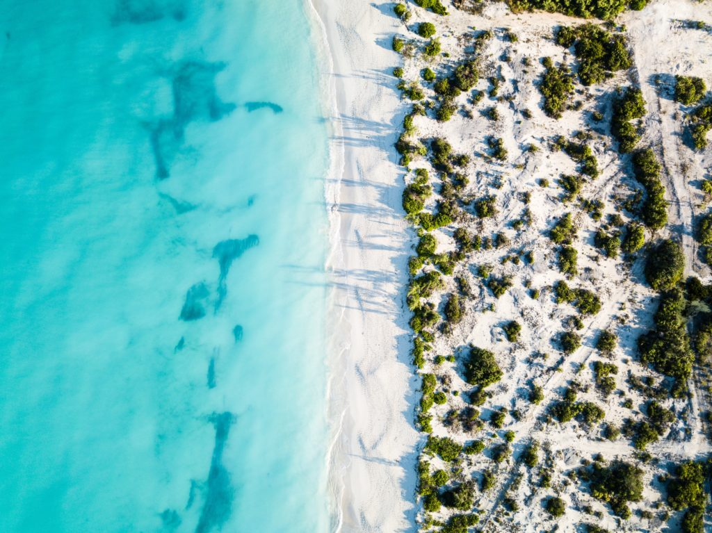 Aerial view of the clear blue waters surrounding Turks and Caicos