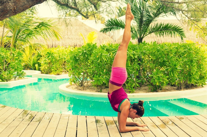 Woman doing a forearm stand at The Beach Tulum yoga hotel